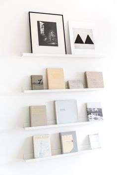The soft blues and grays of these books create a delicate color scheme that is punctuated by the black and white art at the top.