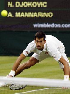 Novak Djokovic wins record grand slam match against Adrian Mannarino at Wimbledon | Herald Sun