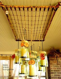 Bottomless jars made into candle holders hang from an old crib spring suspended from the ceiling. Old Bed Springs, Mattress Springs, Old Mattress, Pan Hanger, Crib Spring, Old Cribs, Old Beds, Mason Jar Candles, Bees Knees