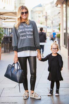 Black, white and grey: Statement sweater, glasses, bun, metallic sneakers, leather skinnies. Via greyandscout