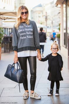 Black, white and grey: Statement sweater, glasses, bun, metallic sneakers, leather skinnies. Via greyandscout