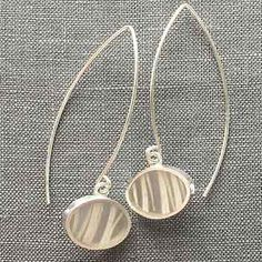 """Carla Pennie McBride: , Sterling silver earrings with forged fine silver wire set in resin. Approximately 1.75"""" long."""