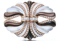 A Pair of French Mother-of-Pearl and Diamond Clips by Mauboussin, circa 1970.  From SJ Shrubsole