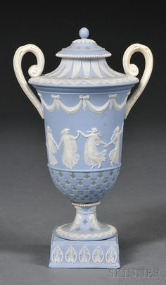 Wedgwood Three-color Jasper Diceware Vase and Cover, England, 19th century, solid light blue ground with applied white classical Dancing Hours in relief below drapery swags and with foliate borders, green quatrefoils.