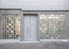 Assorted glass blocks give varying levels of translucency to the facade of this…