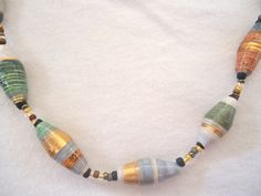 paper bead jewelry chunky long necklace made with hand rolled paper beads in earth tone colors by PrettyPaperMusings on Etsy https://www.etsy.com/listing/205170344/paper-bead-jewelry-chunky-long-necklace