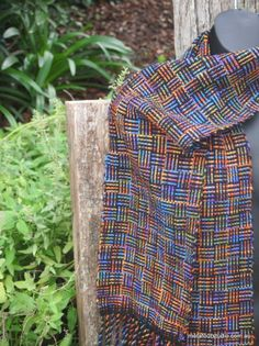 Log cabin pattern handwoven scarf. Woven with multicoloured wool a rigid heddle loom.