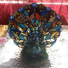 Beautiful vintage peacock lamp.