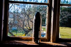 Old anti aircraft shell in the window by David Carlsson on 500px