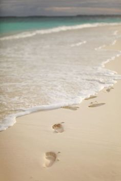 Footprints. Sand. Beach. Getaway. Travel. Retirement.