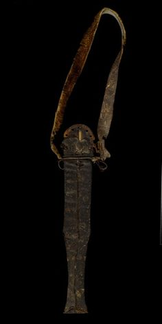 Fang Snake or Monitor Lizard Skin Knife Sheath with Hanging Copper Loop and Animal Skin Handle | collected about 1892 Wood, cooper, animal and reptile skins Overall: 18 1/4 × 3 1/8 × 1 1/8 in. (46.3 × 7.9 × 2.8 cm)