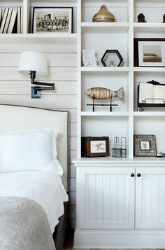 Built Ins Around Bed - horizontal slats and lamps