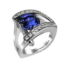 Tanzanite Tension-Set Ring 14k white gold ring features a round 1.0 ct. tanzanite, tension-set at the center of its arching open design, with 0.62 cts. t.w. diamond accents.