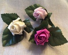 Poly foam rose button holes by Cathey's flowers