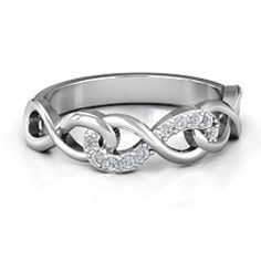 Three interlocked infinity symbols with Diamond or Swarovski Zirconia accents. Personalized this item with your choice of stones and engrave that special message inside the Ring
