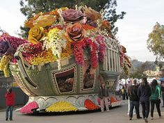 Take my dad to see the Tournament of Roses Parade in Pasadena, CA.