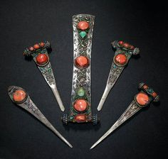 Set of hairpins, Khalka peoples, Central Mongolia, 19C. Silver, enamel, corals, turquoises.