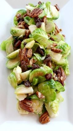 Brussel Sprout Salad Recipe with Pecans and Dijon Mustard Dressing. A healthy and fun way to enjoy Brussels sprouts! All clean eating ingredients are used for this healthy vegetable dish. Pecan Recipes, Vegetarian Recipes, Cooking Recipes, Healthy Recipes, Catering Recipes, Cooking Games, Fast Recipes, Healthy Breakfasts, Crockpot Recipes