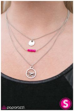 Three strands of dainty silver chain fall into a layered display. A delicately hammered disc and silver charm featuring a bird perched on a branch hang from the upper and lowest chains. Suspended horizontally from the middle chain, pink seed beads are threaded through dainty silver bar for a brilliant splash of color. Features an adjustable clasp closure.    Sold as one individual necklace. Includes one pair of matching earrings.