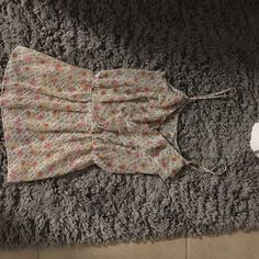 Floral tank top Semi-see through. Ruffles on the front. Hardly worn. Willing to negotiate price! Poetry Tops Tank Tops