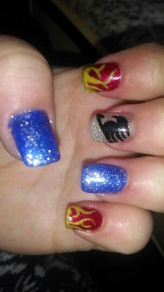 The anime Fairy tail inspired nails flames for Natsu and blue for Grey and the fairy tail guild symbol <3