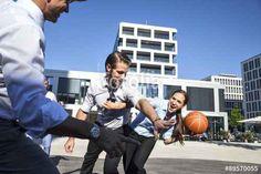 """Laden Sie das lizenzfreie Foto """"Group of businesspeople playing basketball outdoors"""" von firstflight zum günstigen Preis auf Fotolia.com herunter. Stöbern Sie in unserer Bilddatenbank und finden Sie schnell das perfekte Stockfoto für Ihr Marketing-Projekt!"""