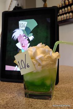 MAD HATTER This drink, appropriately called The Mad Hatter, combines the kick of Vodka, the sweetness of Midori, and an extra little bit of flavor with some Sweet & Sour. Altogether, this drink will surely make you think of that sometimes sweet…and sometimes sour…character from Alice in Wonderland — the Mad Hatter! See the green of his hat and the yellow of his coat?