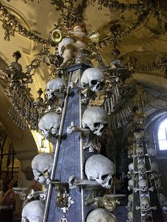 Macabre... The Sedlec Ossuary is a small Roman Catholic chapel, located beneath the Cemetery Church of All Saints (Czech: Hřbitovní kostel Všech Svatých) in Sedlec, a suburb of Kutná Hora in the Czech Republic. The ossuary is estimated to contain the skeletons of between 40,000 and 70,000 people, whose bones have in many cases been artistically arranged to form decorations and furnishings for the chapel. The ossuary is among the most visited tourist attractions of the Czech Republic.