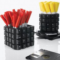 I have so many old keyboards, great idea for the computer geeks in your life...recycled pencil cup Discarded http://walyou.com/category/arts-and-craftsKeyboard and Floppy Disk Make up for a Recycled Pencil Cup