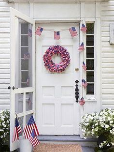 4th of July Wreath!  Easy as can be. (1) Styrofoam Ring & Mini Flag Tooth Picks. Just stick the tooth picks into the wreath until it looks full. Garland: Flags, Twine, & Clothes-pins.
