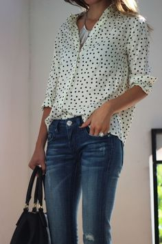 dress up you skinny jeans with a half tucked silk blouse with rolled sleeves; polka dots, paisley and animal prints are on trend