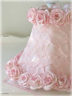 Featuring soft pink rose petals and trimmed with gorgeous matching Mulberry…