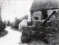 A knocked out Tiger tank in France. On the rear painted in white are two SS Siegrunes.