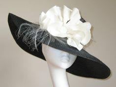 Black straw floppy hat with crinoline and cream poppy