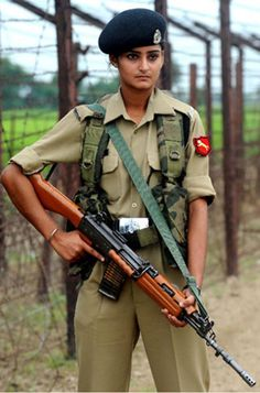 Female Indian Soldier with the INSAS LMG-The INSAS assault rifle is the standard infantry weapon of the Indian Armed Forces.