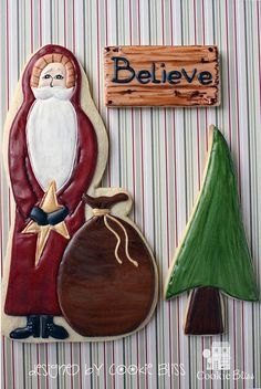 Santa with gift bag, tree and Believe sign cookies.