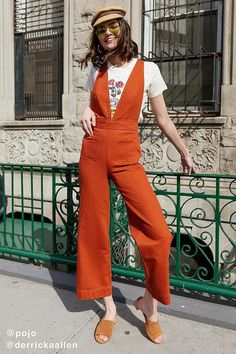 062f94aa1c9 Slide View  1  UO Eleanor Plunging Denim Jumpsuit 70s Fashion