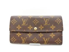 Get the trendiest Clutch of the season! The Louis Vuitton Wallet Tresor Porte Monogram Bifold Sarah 235425 Brown Coated Canvas Clutch is a top 10 member favorite on Tradesy. Louis Vuitton Clutch, Louis Vuitton Monogram, Retail, Coding, Exterior, France, Ship, Number, Pocket