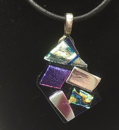 A personal favorite from my Etsy shop https://www.etsy.com/listing/462997231/dichoric-fused-glass-necklace