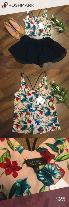 Topshop Tropical Print Tank Top This Tropical Print  Tank Top by Topshop is sure to get compliments. Features a double strap detailing in the back. I paired with some elmerald green ruffle shorts and some mustard heels. NEW WITH TAGS Topshop Tops Tank Tops