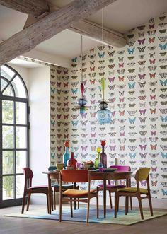 Love this bright and airy dining room with graphic butterfly wallpaper and colourful accessories #BotanicalByHarlequin