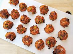 Paleo Pizza Bites! These little bite-sized snacks taste just like a bite of pizza, but are made from primarily meats & veggies (with just a little egg & coconut flour to bind them together). You would never believe the #1 ingredient is cauliflower!
