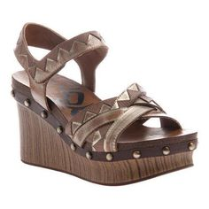 """The Eccentric is a chunky ankle-strap platform wedge sandal with lots of decorative detailing. Leather Upper Adjustable Ankle Strap Manmade Outsole. Heel Height: 4"""" Origin: Imported Fit: True to Size"""
