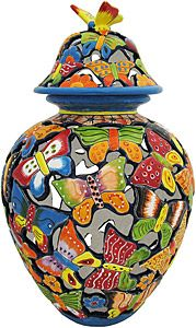 If you are in love with Southwestern decor or simply want to add some Southwestern/ South of the Border style to your home, our collection of Talavera jars and vases are sure to do the trick. These colorful, interconnected butterflies are handmade of clay in the classic Talavera style and then hand-painted by specialized artists outside of Dolores Hidalgo, Mexico.