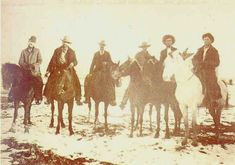 Extremely rare photo of Billy when captured at Stinking Springs, December 24th 1880. Billy is on the extreme right where a deputy aims a Colt revolver at Billy's head.