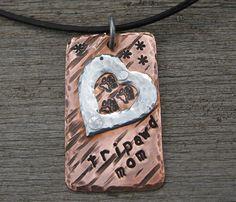 Three Paw Tripawd Dog Mom Pet Lover's Necklace Charm. $29.95, via Etsy.