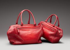 Modern elegance, meticulous craftsmanship and effortless functionality are combined and enhanced by the subtly textured Madras Sfumato leather, which is deeply rooted in the heritage of Bottega Veneta as it's first signature. Pairs perfectly with the seasons artfully constructed dresses and exotic kissed loafers.