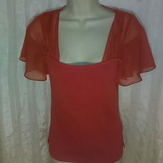 DUE PER DUE TOP-SIZE S-REALLY CUTE!!! -DUE PER DUE Top -Size Small -Really Cute!!!! -Sleeves and top part is very sheer material -Burnt Orange Color -48% Rayon, 45% Nylon, 7& Spandex DUE PER DUE Tops