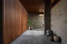 Architect Alexis Dornier has completed 'The River House', a modern home in Pererenan, Bali, that uses reclaimed timber and locally sourced sandstone throughout its design. Hidden Lighting, Glass Railing, Wood Stairs, Lokal, Reclaimed Timber, Wood Blinds, Architect House, River House, Sliding Glass Door