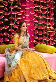 Bride in a yellow lehenga with floral embroidery with contrasting printed dupatta on her mehndi function Bridal Dupatta, Bridal Mehndi Dresses, Mehendi Outfits, Muslim Wedding Dresses, Wedding Dresses For Girls, Indian Wedding Outfits, Bridal Outfits, Girls Dresses, Mehndi Dress For Bride